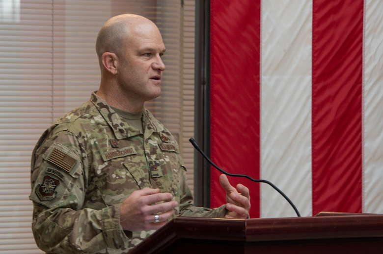 U.S. Air Force Col. David Hammerschmidt, 60th Aircraft Maintenance Group commander, delivers the opening remarks during the Key Spouse Recognition event at the 60th MXG atrium Feb. 8, 2019, at Travis Air Force Base, California. The Key Spouse Program is an Air Force-wide volunteer program that builds and fosters support for military families through outreach education events and providing families a link to leadership.(U.S. Air Force photo by Heide Couch)