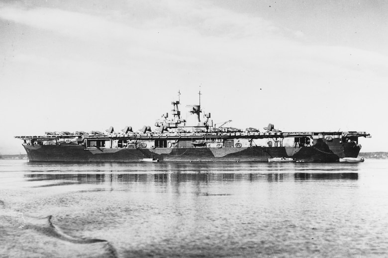 File photo of USS Wasp (CV 7) in Casco Bay, Maine, circa early 1942, with SB2U and F4F aircraft on her flight deck. Wasp is painted in a Measure 12 (Modified) camouflage pattern.