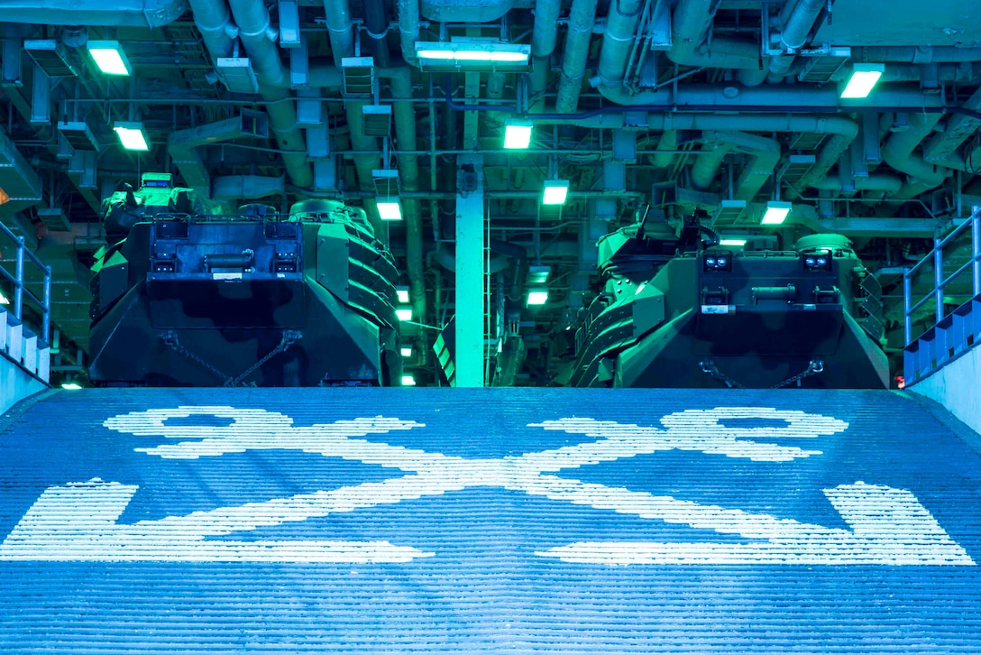 Vehicles are stored on a ship.