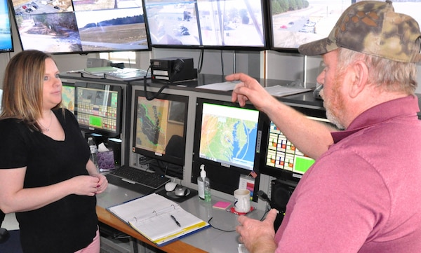 "IMAGE: DAHLGREN, Va. (March 4, 2019) - Jennifer Ferrell - administrative lead for the Test and Evaluation Division at Naval Surface Warfare Center Dahlgren Division (NSWCDD) - listens intently as Donnie Preston, NSWCDD Potomac River Test Range (PRTR) Operations Center senior technician, briefs her on range operations. Ferrell is responsible for financial and human resources actions and financial management of the division, including PRTR. ""The faster we can get funds properly in place, the faster we can execute the technical work to get the products delivered to the warfighter,"" said Ferrell. ""I find pride in knowing that even though my role is non-technical, I can still make an impact to our warfighters by promoting more efficient financial and human resources policies and processes."""
