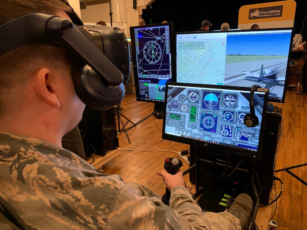 Staff Sgt. Joseph Sabin, Air Education and Training Command Technology Integrated Detachment, flies a virtual-reality sortie at the Pilot Training Next Technology Expo at Joint Base San Antonio-Randolph, Texas, March 12, 2019. Technology currently being used at PTN was on display at the expo and subject matter experts and technology vendors were available to talk with attendees. (U.S. Air Force photo by Dan Hawkins)