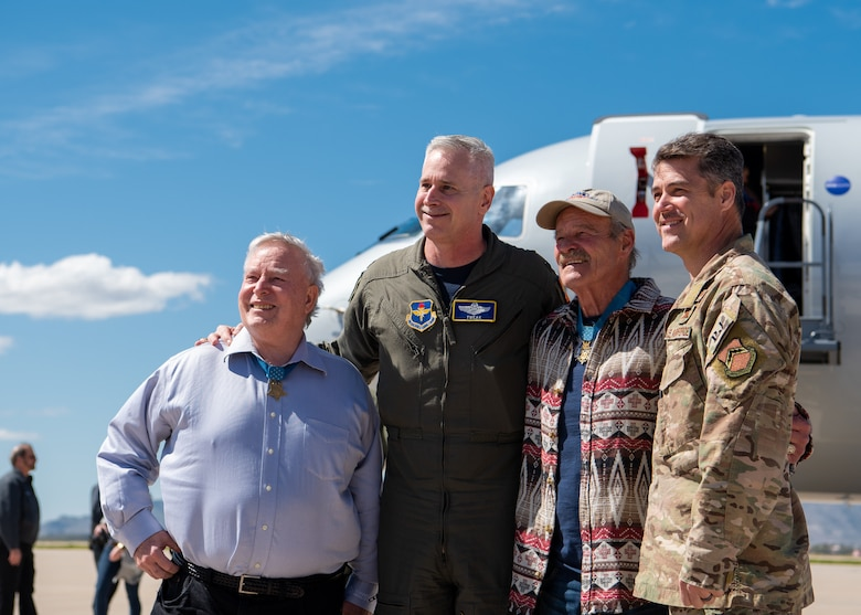 Medal of Honor recipients Donald Ballard and John Baca pose for a photo with Col. Michael Richardson, 56th Fighter Wing vice commander and Chief Master Sgt. Ronald Thompson, 56th FW command chief, March 8, 2019 at Luke Air Force Base, Ariz.