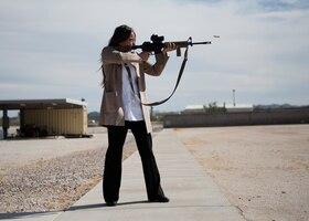 Valerie Berube, community partnerships director at Luke Air Force Base, fires a rifle at the Maricopa County Sheriff's Office Firing Range in Buckeye, Ariz., Feb. 25, 2019.