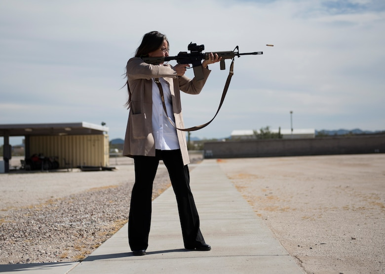 Valerie Berube, community partnerships director at Luke Air Force Base, fires a rifle at the Maricopa County Sheriff's Office Firing Range in Buckeye, Ariz., Feb. 25, 2019.