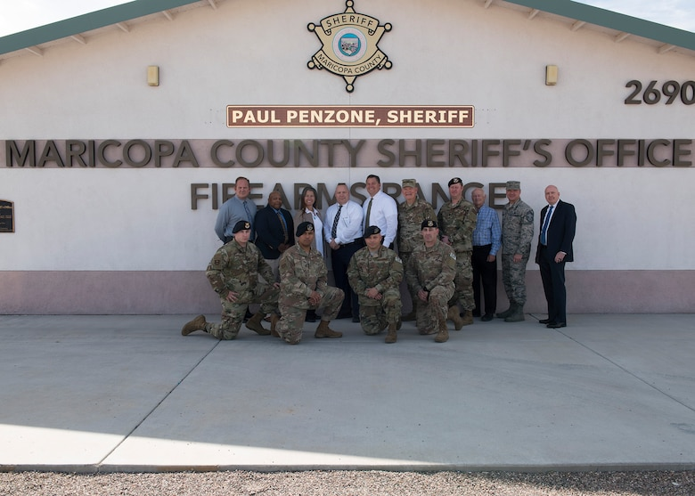 Luke Air Force Base and Maricopa County Sheriff's Office personnel pose at the Maricopa County Sheriff's Office Firing Range in Buckeye, Ariz., Feb. 25, 2019.