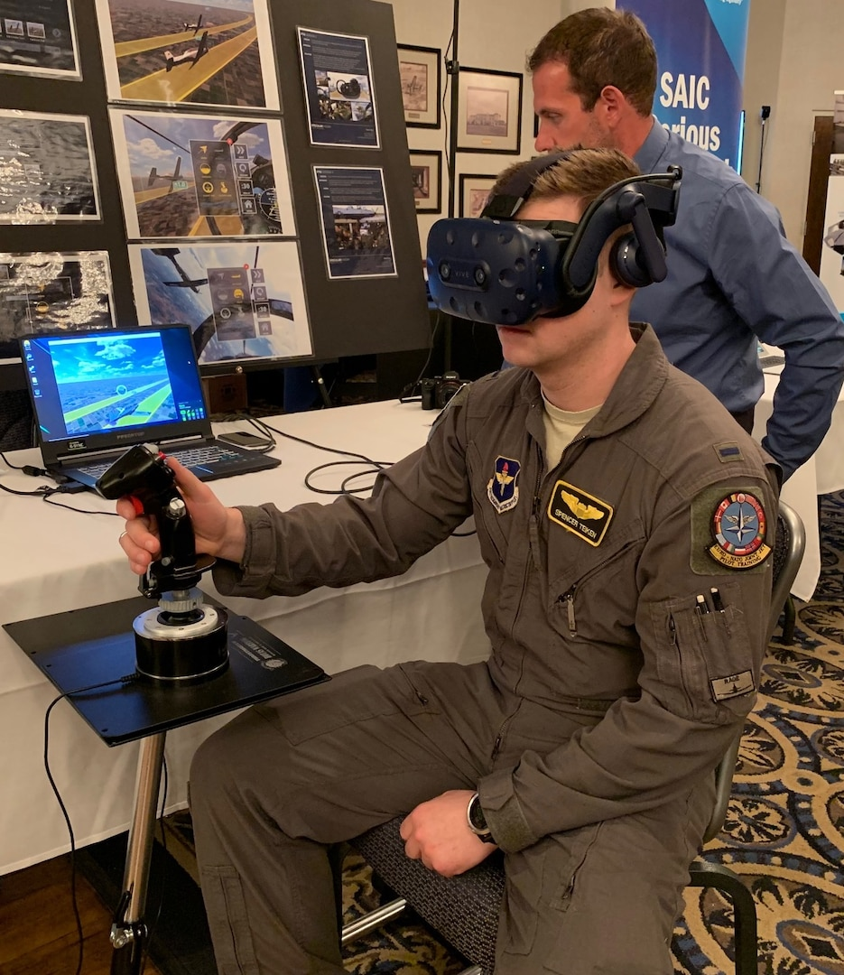 First Lt. Spencer Teiken from the 80th Operational Support Squadron at Sheppard Air Force Base, Texas, works through a virtual simulation problem during the Pilot Training Next Technology Expo at Joint Base San Antonio-Randolph March 12. Technology currently being used at PTN was on display at the expo and subject matter experts and technology vendors were available to talk with attendees.