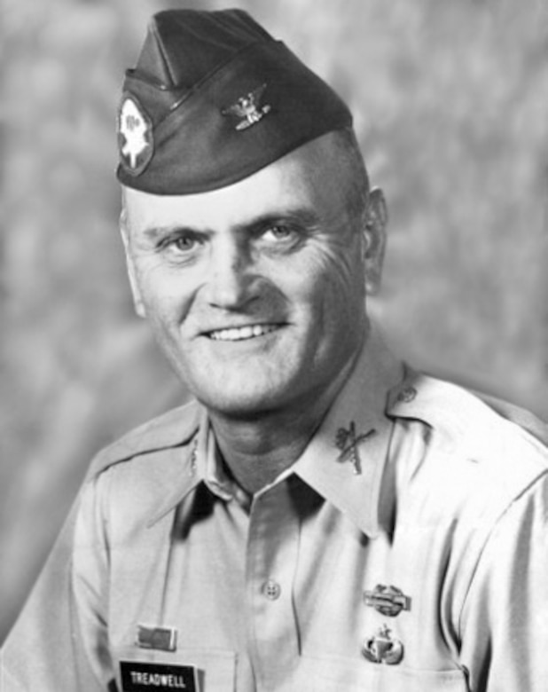 Official photo of a man in his Army dress uniform.