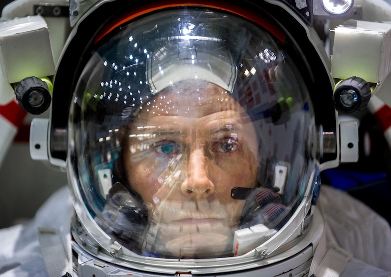 Col. Tyler N. Hague, a NASA astronaut, waits to be lowered into the pool containing a mock-up of the International Space Station at the Johnson Space Flight Center's Neutral Buoyancy Laboratory for Extravehicular Activity training in Houston, Texas, April 27, 2017. (U.S. Air Force photo by J.M. Eddins Jr.)