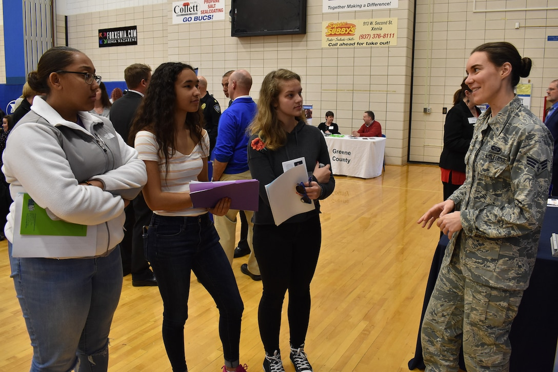 655th Intelligence, Surveillance, and Reconnaissance Wing, 71st Intelligence Squadron analyst Senior Airman Newman speaks with senior class students at Xenia High School, Xenia, Ohio, during a career fair held at the school March 13, 2019.  Newsome joined other members of the 71st and 14th Intelligence Squadrons in promoting the 655th mission as well as the opportunities and benefits available in the United States Air Force Reserve. The event was sponsored by the Ohio Means Jobs Greene County office.
