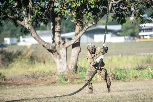 A U.S. Soldier lands on the ground after sliding down a rope from a UH-60 Blackhawk in Ilopango, El Salvador, March 6, 2019.