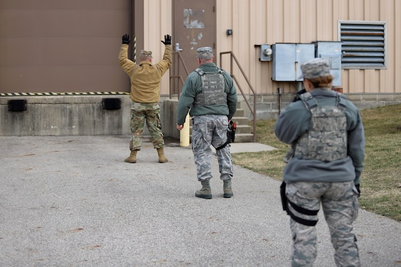 photo of Security Forces Airmen providing augmentee training