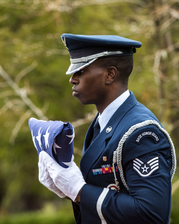 Staff Sgt. Marcus Hardy, Vandenberg Honor Guard flight chief and lead trainer, prepares to pass the flag to the next-of-kin during a U.S. Air Force active duty funeral March 2, 2019, in Camarillo, Calif. During a military funeral, guardsmen have the opportunity to either present the colors, be a member of the firing team or carry the casket with a flag draping over the fallen veteran. (U.S. Air Force photo by Airman 1st Class Aubree Milks)