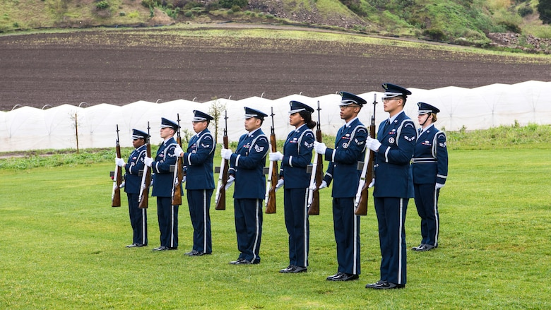 A Vandenberg Honor Guard riffle team fires three volleys during the U.S. Air Force active duty funeral March 2, 2019, in Camarillo, Calif. It is a military tradition to fire three volleys, where each riflemen fires blank cartridges into the air three times, to honor the deceased veteran. (U.S. Air Force photo by Airman 1st Class Aubree Milks)
