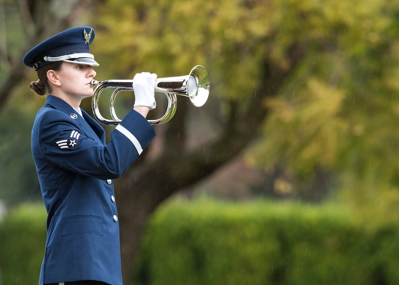 Senior Airman Daniella Boni, Vandenberg Honor Guard ceremonial guardsmen, plays taps with the bugle during a U.S. Air Force active duty funeral March 2, 2019, in Camarillo, Calif. Taps is a bugle call played at dusk on military installations, during flag ceremonies and at military funerals by the United States Armed Forces. Taps replaced the formal Lights Out in 1862 when Union General Daniel Adams Butterfield dedicated the song to honor 600 men who were killed in battle. (U.S. Air Force photo by Airman 1st Class Aubree Milks)
