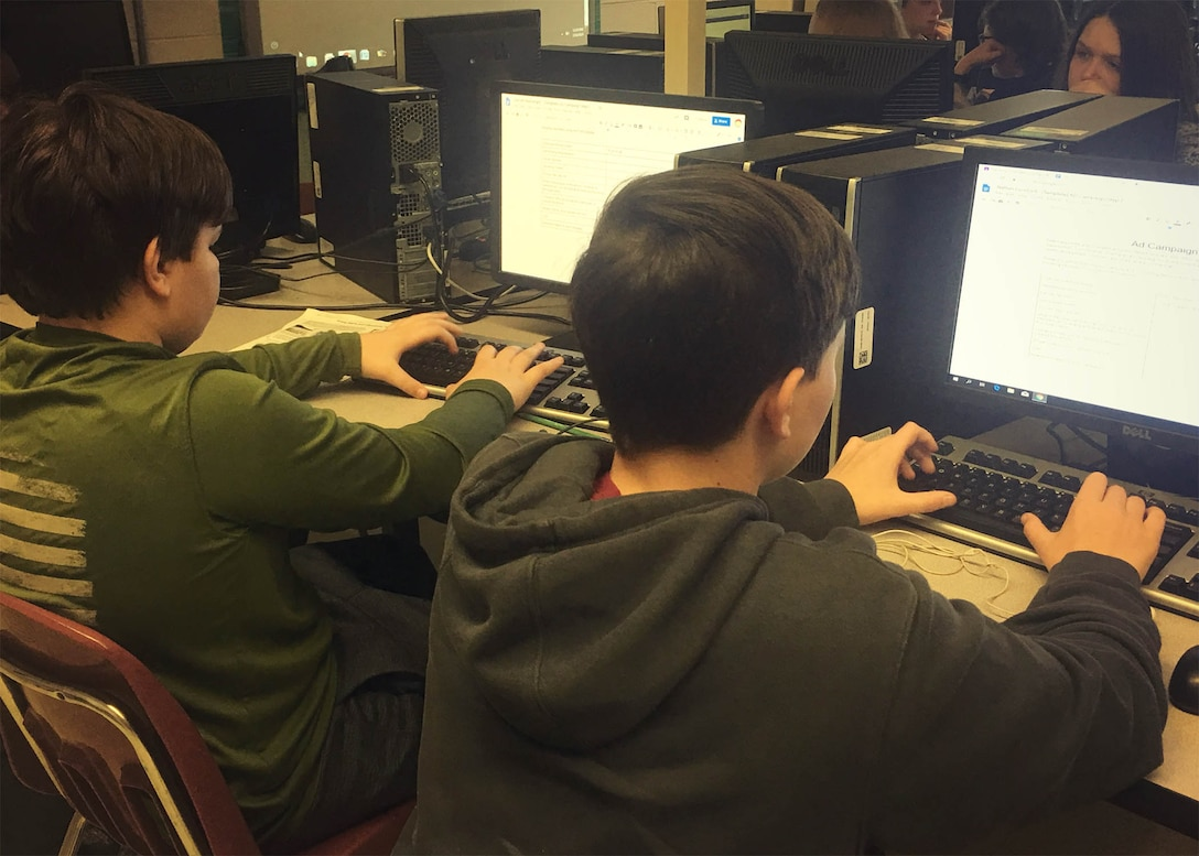 Students taking the journalism elective use the donated machines.