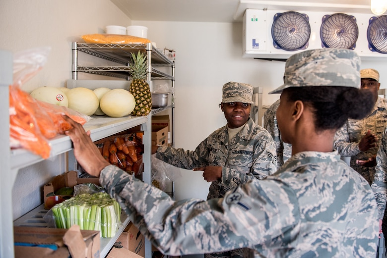 Airmen assigned to the 512th Memorial Affairs Squadron conduct a food inventory during the 2019 John L. Hennessy competition at Dobbins Air Reserve Base, Georgia, March 8, 2019. Competing teams were tasked with ordering food for their menus two months prior to the competition on March 9. (U.S. Air Force photo by Staff Sgt. Damien Taylor)