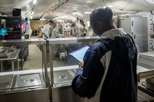 Pauletta Thompson, 94th Airlift Wing bioenvironmental engineer, evaluates the 512th Memorial Affairs Squadron cooking team at Dobbins Air Reserve Base, Georgia, March 9, 2019. The 512th MAS cooking team were evaluated on excellence in management, force readiness support, food quality and production, and safety awareness. (U.S. Air Force photo by Staff Sgt. Damien Taylor)