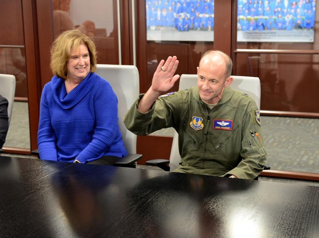 """Brig. Gen. E. John Teichert, 412th Test Wing commander, raises his hand to """"slap the table"""" to symbolically solidify a formal multi-year partnership to conduct alternating air shows within the region at the Learn4Life meeting room in Lancaster, California, March 13. This paves the way to resume air shows at Edwards Air Force Base, the new schedule will bring a """"double header"""" air show year for the region, with air shows scheduled for March 2020 at General William J. Fox Air Field in Lancaster and October 2020 at Edwards Air Force Base. After 2020, the air shows will alternate with Edwards' as the venue on even years, and Fox Field hosting on odd years. (U.S. Air Force photo by Michelle Thomas)"""