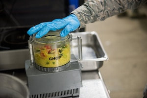 Senior Airman Samoya Nicholson, 512th Memorial Affairs food services shift supervisor, blends peppers and vegetables during the John L. Hennessy food service competition at Dobbins Air Reserve Base, Georgia, March 9, 2019. Four Air Force Reserve Command units competed on different dates utilizing the Dobbins ARB Silver Flag site kitchen to compete. (U.S. Air Force photo by Staff Sgt. Damien Taylor)