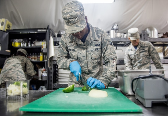 Senior Airman Samoya Nicholson, 512th Memorial Affairs food services shift supervisor, slices a pepper during the John L. Hennessy food service competition at Dobbins Air Reserve Base, Georgia, March 9, 2019. The 2019 John L. Hennessy food service competition was held at Dobbins ARB's Silver Flag site. (U.S. Air Force photo by Staff Sgt. Damien Taylor)