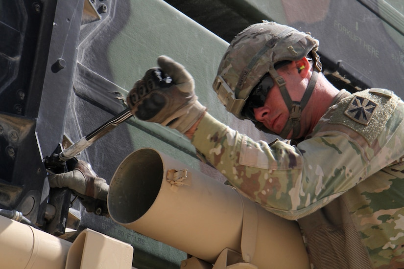 Army Pfc. John Whittle, a Patriot Hot Crew members with Battery C, 1st Battalion, 43rd Air Defense Artillery Regiment, loosens a bolt on a Patriot missile during a missile reload operation March 7, 2019. The Soldiers continually train and conduct battle drills to ensure they are able to perform their duty in providing air defense support across the U.S. Central Command area of responsibility.