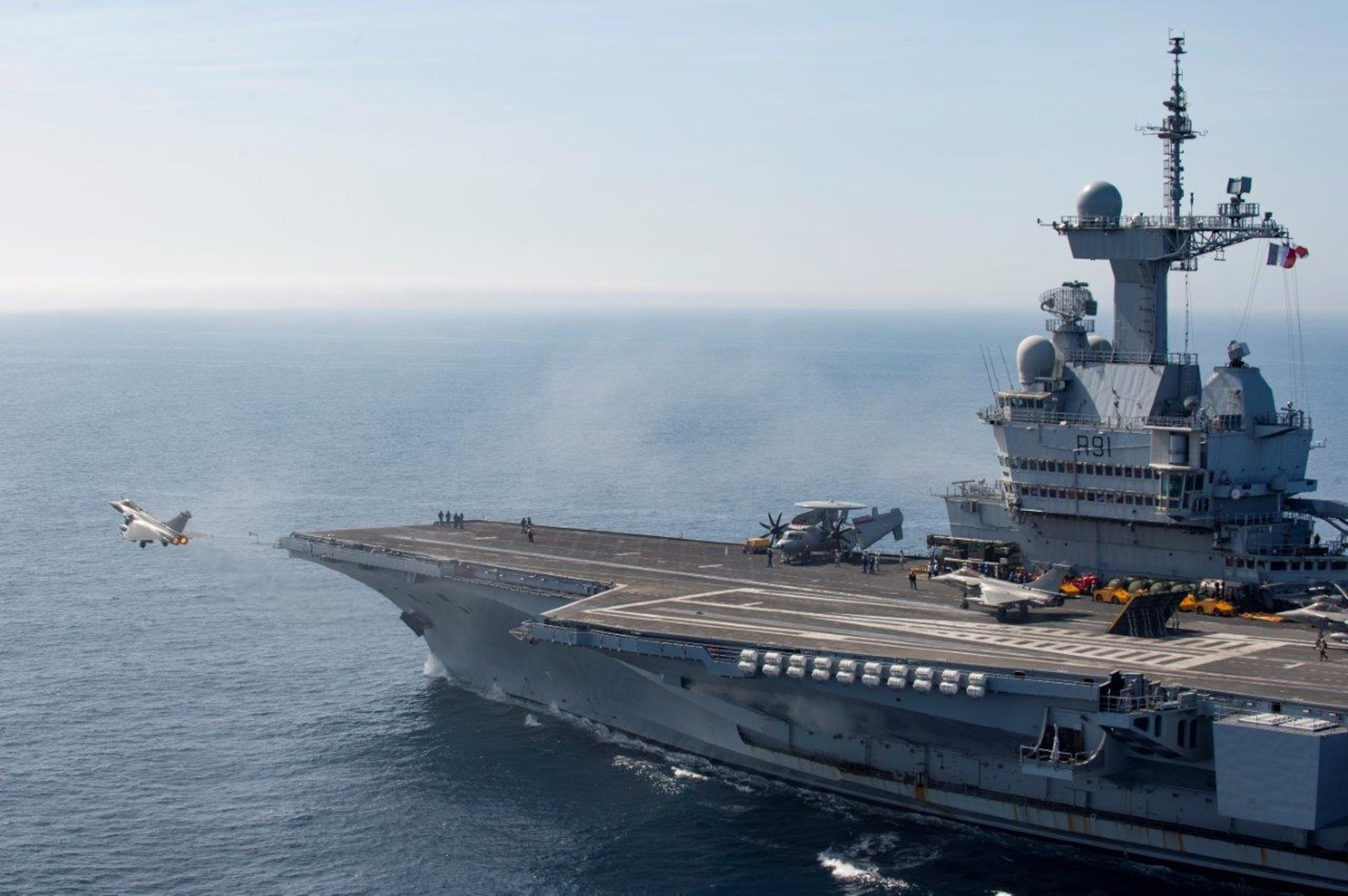 On 13th March 2019, the French Carrier Strike Group, CTF473 arrived off-shore Syria to support Combined Joint Task Force Operation Inherent Resolve. The Carrier Strike Group is composed of the Aircraft carrier Charles-de-Gaulle, the Danish frigate Daniel Juel, and an attack submarine among other assets. The Charles-de-Gaulle launched Rafale Marine and Hawkeye aircraft to support coalition troops on the ground and gather intelligence while other air assets and vessels were conducting air and maritime control operations.  The arrival of the CSG reinforces French military capabilities involved in Operation CHAMMAL and strengthens the Coalition against ISIS. The French air carrier group is familiar with this theater of operations in the Levant since it has already conducted three previous Arromanches missions since January 2015, which is a significant commitment to the military campaign against ISIS. This capacity building illustrates the determination of France and the coalition to complete the military defeat of ISIS.