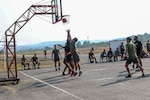 A Philippine army soldier makes a basket during a game of basketball played against U.S. Army Soldiers during a sports day held as part of Exercise Salaknib 19 at Fort Magsaysay, Philippines, March 11, 2019. Salaknib is an annual exercise designed to contribute to and enhance U.S. and Philippine defense readiness and tactical interoperability while strengthening multinational relationships.
