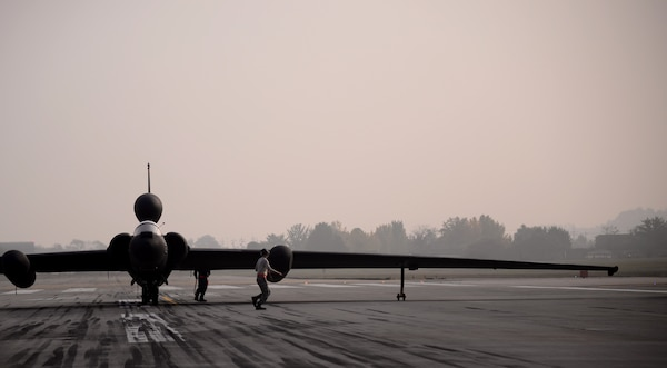 Airmen perform last-minute checks on a U-2 reconnaissance aircraft before it takes from Osan Air Base, Republic of Korea. Huntsville Center's Fuels team cleaned, inspected and repaired a fuel storage tank used to hold and dispense  a jet fuel created specifically for the reconnaissance aircraft, an important part of the Air Force's intelligence, surveillance and reconnaissance  mission enterprise.
