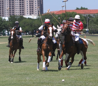 Players charge after a free ball in a polo match May 5, 2018, at Joint Base San Antonio-Fort Sam Houston. The match was the first time polo was played on the base in more than 50 years. A polo match would've been a common sight on Army bases in the early 20th century. Notable advocates and players included Gen. John Pershing, Gen. George Patton Jr., and Medal of Honor recipient Col. Gordon Johnston. The USPA created the Col. Gordon Johnston Sportsmanship Award in his honor.