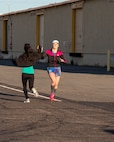 Ruth Clemans and Rose Schwartz high five each other as they finish their daily training aboard Marine Corps Logistics Base Barstow, California, for upcoming marathons, March 7. Schwartz will be racing in the LA Marathon to be held in March and Clemans will be racing in the Duluth Marathon in June, where she plans to qualify for the Boston Marathon 2020.
