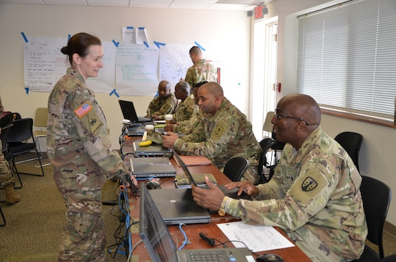 Capt. Beth Appleman, logistics support officer with 1st Logistics Civil Augmentation Program Support Battalion, takes a moment to discuss the importance of understanding the area of operations and requests from the requiring activity