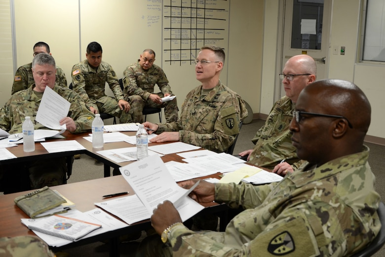 The MOC Joint Readiness Review Board analyzes a team's statement of work and letter of justification.  The culminating portion of the mobilization exercise was a simulated Joint Readiness Review Board where each team presented their statement of work and letter of justification before the commander, the command sergeant major, and the staff sections.