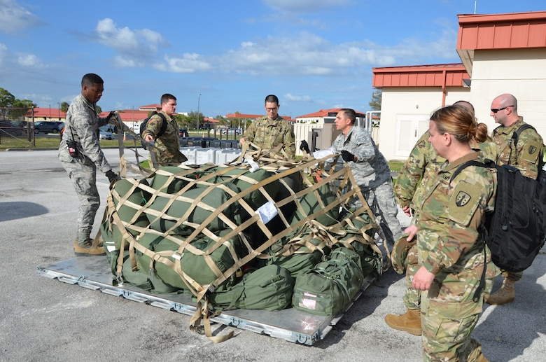 Soldiers with the 1st and 2nd Logistics Civil Augmentation Program Support Battalions from Fort Belvoir, Virginia and Air Force Soldiers stationed at MacDill Air Force Base uncrate cargo upon their arrival to conduct a mobilization exercise.