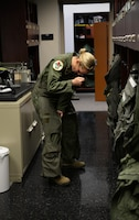 Maj. Andrea Matesick, 49th Fight Training Squadron weapons system officer, tightens her G-suit before a training sortie March 7, 2019, on Columbus Air Force Base, Mississippi. Introduction to Fighter Fundamentals builds upon the training learned in Specialized Undergraduate Pilot Training with a major focus on the fundamentals, or basics, of tactical aviation. (U.S. Air Force photo by Airman Hannah Bean)