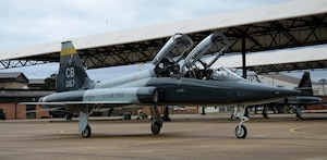 Maj. Andrew Pence, 49th Fighter Training Squadron instructor pilot, and 2nd Lieutenant Kennan Allen, 49th FTS student pilot, move to the runway to begin flight for a training sortie, March 7, 2019, on Columbus Air Force Base, Mississippi. The 49th FTS holds a high standard in Introduction to Fighter Fundamentals to ensure the pilots that leave the squadron are highly capable of adapting and overcoming challenges when needed with their wingmen in an extremely challenging career. (U.S. Air Force photo by Airman Hannah Bean)