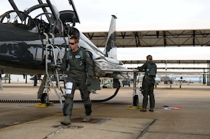 Maj. Michael Overstreet, 49th Fighter Training Squadron assistant director of operations, and Maj. Andrea Matesick, 49th Fight Training Squadron weapons system officer, check over a T-38C Talon in preparation for a sortie March 7, 2019, on Columbus Air Force Base, Mississippi. Pilots dedicate a great deal of time and effort to ensure the aircraft is fully prepared for flight and soundly running. (U.S. Air Force photo by Airman Hannah Bean)