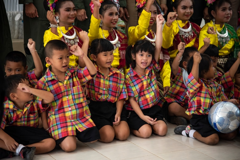 Ban PaLai School children cheer after receiving donations from the U.S., Royal Thai and Singaporean air forces during a COPE Tiger 2019 cultural exchange at Korat, Thailand, March 13, 2019.