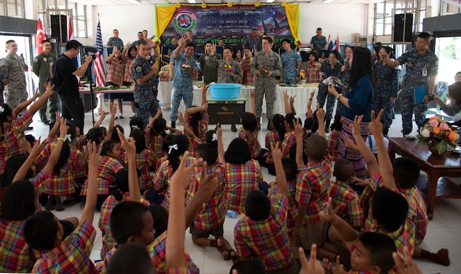 U.S., Royal Thai, and Singaporean Airmen participate in a team-building competition with Ban PaLai school kids during a COPE Tiger 2019 cultural exchange at Korat, Thailand, March 13, 2019.
