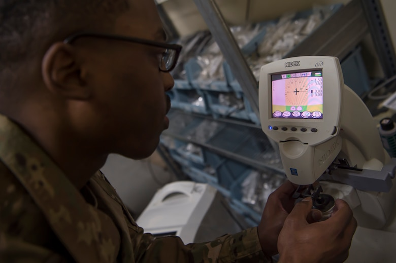 U.S. Army Spc. Justin Jones, 354th Medical Company Logistics Support optical laboratory specialist, 8th Medical Brigade, Area Support Group - Qatar, fabricates lenses for glasses March 9, 2019, at Camp As Sayliyah, Qatar. Jones is part of a team that grinds and frames glasses from data provided by a U.S. Air Force optometry team from Al Udeid Air Base, Qatar. (U.S. Air Force photo by Tech. Sgt. Christopher Hubenthal)