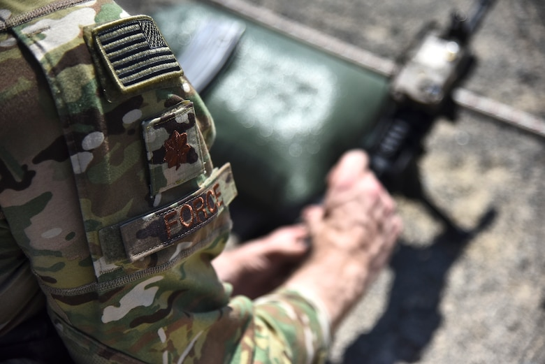 Maj. Michael Force, 380th Expeditionary Security Forces Squadron commander, adjusts the sights on his M4 Carbine weapon at Al Dhafra Air Base, United Arab Emirates, March 8, 2019. The M4 is a lightweight, gas operated, air cooled, magazine fed, selective rate, shoulder fired weapon with a collapsible stock, and is now the standard issue firearm for most units in the U.S. military. (U.S. Air Force photo by Senior Airman Mya M. Crosby)