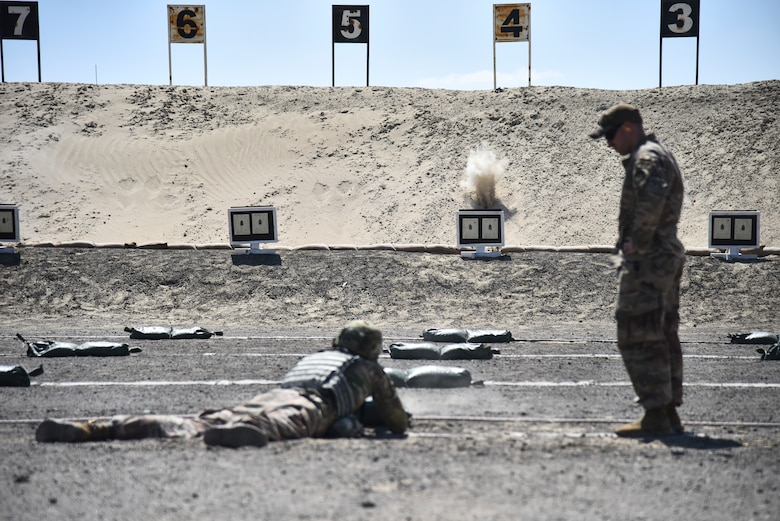 Staff Sgt. Bradley Nendel, 380th Expeditionary Security Forces Squadron NCO in charge of armory, supervises an Airman zeroing their weapon at Al Dhafra Air Base, United Arab Emirates, March 8, 2019. Security Forces Airmen are responsible for missile security, defending air bases around the globe, law enforcement on those bases, combat arms and handling military working dogs. (U.S. Air Force photo by Senior Airman Mya M. Crosby)