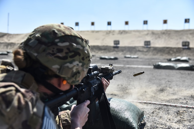 Master Sgt. Leigh Weigold, 380th Expeditionary Security Forces Squadron section chief of plans and programs, fires her weapon at Al Dhafra Air Base, United Arab Emirates, March 8, 2019. As the largest career field in the Air Force, it's the job of Security Forces to protect, defend and fight to enable U.S. Air Force, Joint and Coalition missions. (U.S. Air Force photo by Senior Airman Mya M. Crosby)
