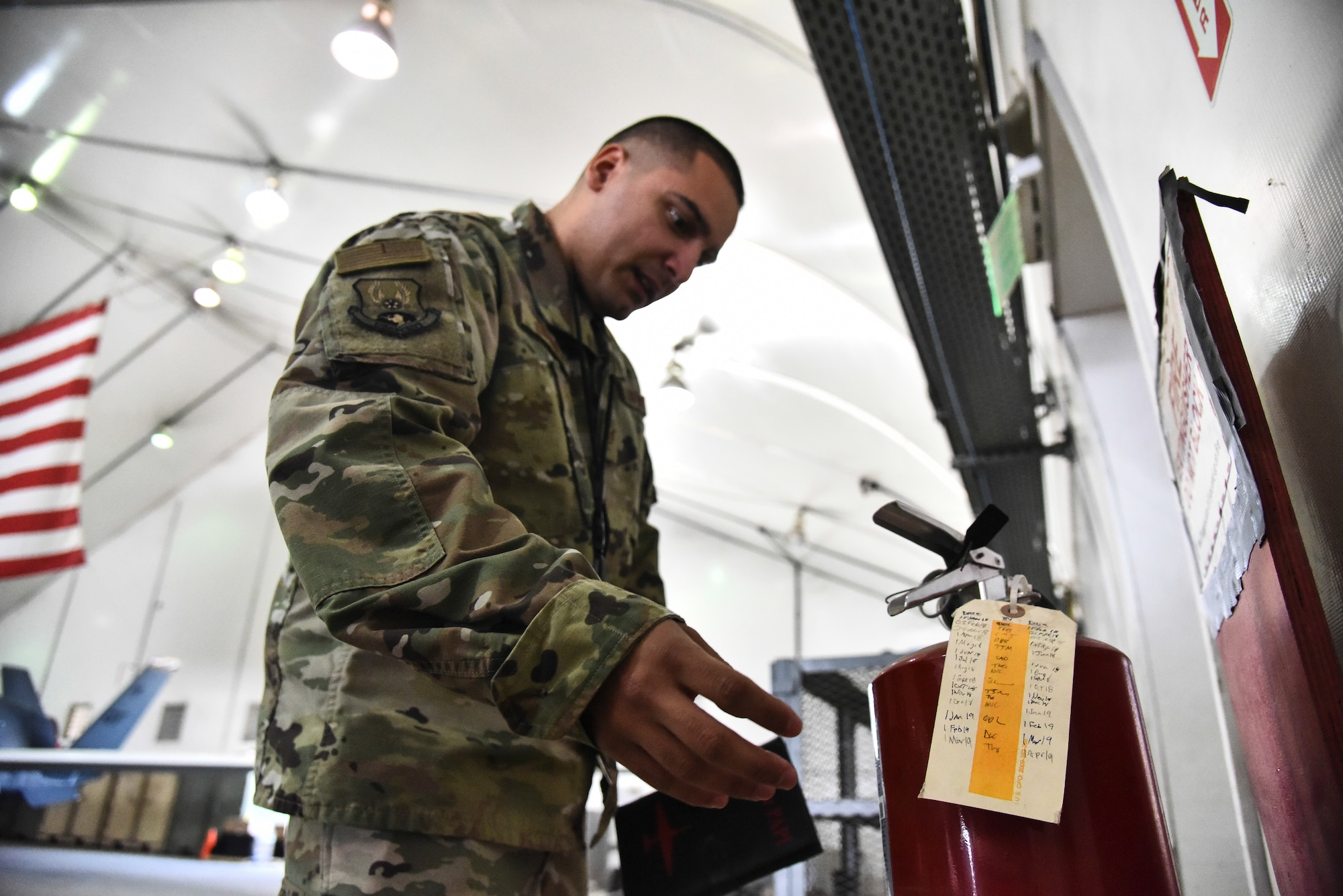 Staff Sgt. Luis Rosa, 380th Expeditionary Maintenance Group RQ-4 Global Hawk and U-2 Dragon Lady quality assurance inspector, inspects a fire hydrant in an aircraft hangar at Al Dhafra Air Base, United Arab Emirates, March 12, 2019. QA Airmen serve as the primary technical advisory agency in the maintenance organization, assisting maintenance supervision at all levels to identify, validate and/or resolve workmanship, proficiency and/or compliance issues impacting mission generation. (U.S. Air Force photo by Senior Airman Mya M. Crosby)