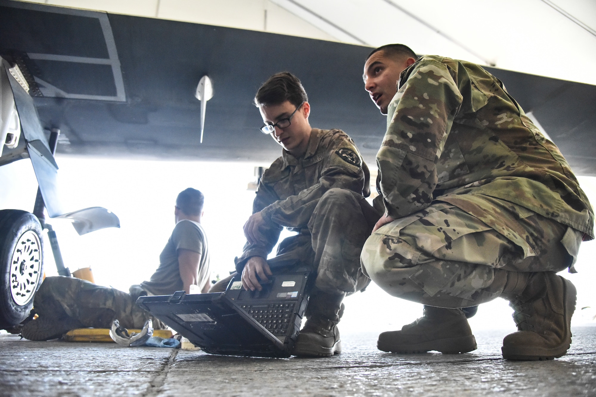 Staff Sgt. Luis Rosa, 380th Expeditionary Maintenance Group RQ-4 Global Hawk and U-2 Dragon Lady quality assurance inspector, inspects an RQ-4 Global Hawk and its crew at Al Dhafra Air Base, United Arab Emirates, March 12, 2019. QA is responsible to the Maintenance Group commander or equivalent to perform as the primary technical advisory agency for maintenance actions and to assist work center supervisors in reviewing tasks involved in supporting the maintenance effort. (U.S. Air Force photo by Senior Airman Mya M. Crosby)