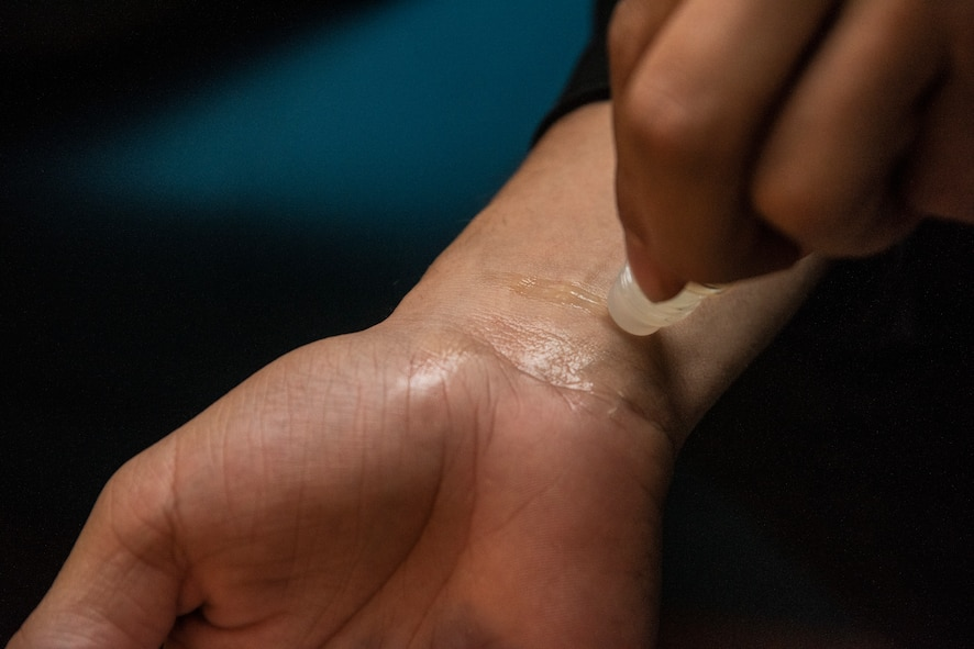 U.S. Air Force Senior Airman Dylan White, a 35th Security Forces Squadron military working dog handler, tests his new lavender oil roller on his wrist during an essential oils class at Misawa Air Base, Japan, March 12, 2019. White, along with eight other attendees received free oil samples and talked with each other, hearing stories of how others used oils in their home. (U.S. Air Force photo by Senior Airman Sadie Colbert)