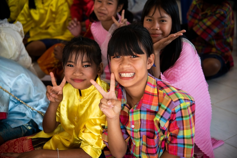 Two Ban PaLai School children pose for a photo during a COPE Tiger 2019 cultural exchange at Korat, Thailand, March 13, 2019.