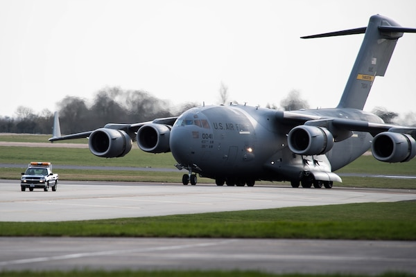 A C-17 Globemaster III from Charleston Air Force Base, S.C., taxis down the flight line at RAF Fairford, England, March 9, 2019. Multiple C-17s were required to deliver all the support equipment needed to support the U.S. Strategic Command Bomber Task Force (BTF) in Europe. (U.S. Air Force photo by Airman 1st Class Tessa B. Corrick)