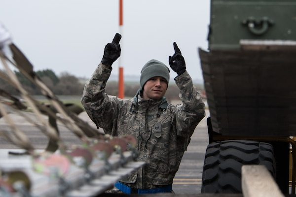 Staff Sgt. Scot Boone, 2nd Logistics Readiness Squadron training validation and operation noncommissioned officer in charge, deployed from Barksdale Air Force Base, La., directs a 2nd LRS vehicle operator at RAF Fairford, England, March 9, 2019. The team loaded cargo to deliver to various units on base to begin U.S. Strategic Command Bomber Task Force (BTF) in Europe.