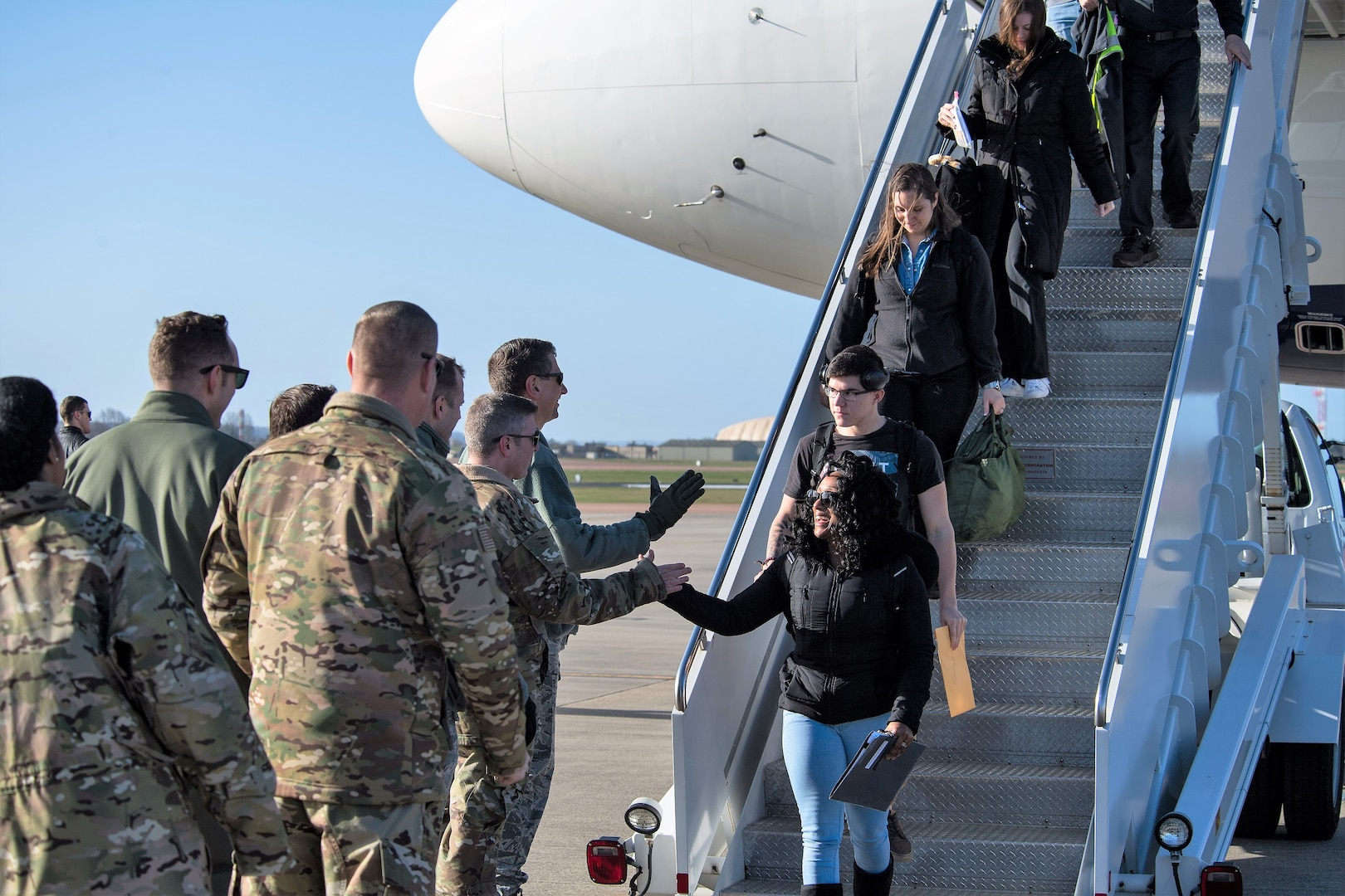 Leadership deployed from Barksdale Air Force Base, La., welcome their deployed Airmen to RAF Fairford, England, March 11, 2019. During their deployment, the Airmen will work around the clock to support U.S. Strategic Command's Bomber Task Force (BTF) in Europe.
