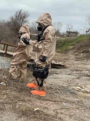 Two members of the 61st Civil Support Team, 87th Troop Command, Arkansas National Guard, don HAZMAT suits and search for chemical spills during a training exercise in West Memphis, Arkansas on March 13, 2019. The unit was involved in a New Madrid earthquake response exercise alongside several civilian emergency response agencies.